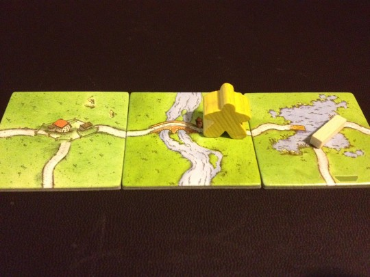 The Yellow player positions the Ferry to make sure they can score the Road this turn.