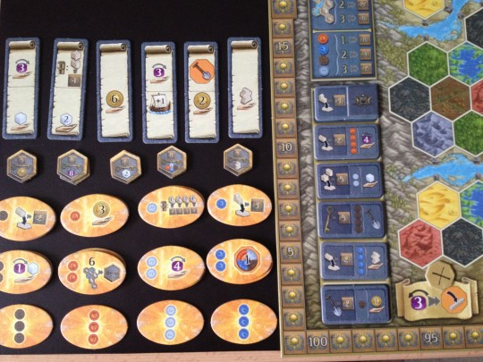 The board is set up, the tokens are in piles and the game is ready to begin!