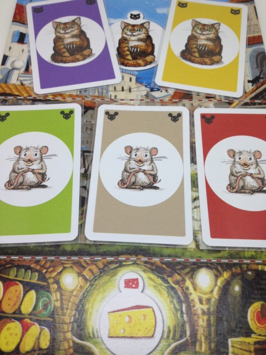 The Two cats eat one Mouse each, the other Mouse card is removed form play and will not score for any player.
